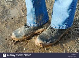 dirty pair dirty pair of muddy builders boots stock photo royalty free image