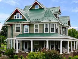 green metal roof houses