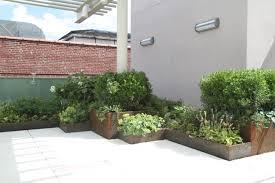 corten steel planters caliper studio