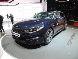 new kia optima sw estate puts style above space auto express