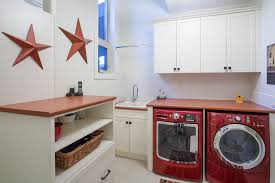 laundry room folding table ideas laundry room traditional with red