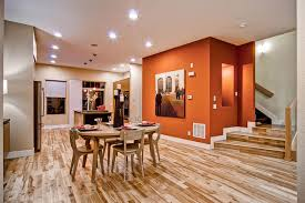 orange wall contemporary dining room