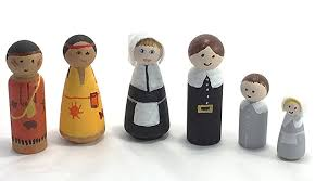 painted wooden thanksgiving pilgrims and