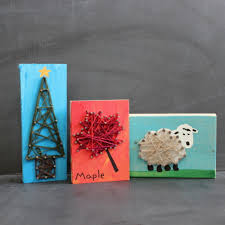 using a wood block make a picture hammer nails around the