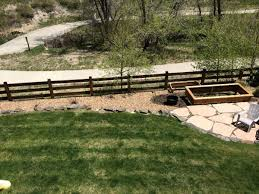 need landscape suggestions rock edging slope near split rail fence