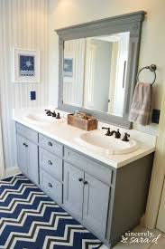 Painting Bathroom Walls Ideas This Bathroom Features Gray Walls Gray Vanity And Gray Penny Round