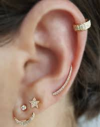 second earrings earring stacking is the new jewelry trend you might want to try