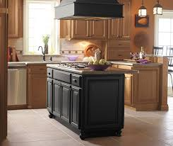 kitchen island with cabinets light oak cabinets with a black kitchen island masterbrand