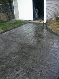 Backyard Concrete Patio by Gray Ashlar Slate Stamped Concrete Patio With Stained Black