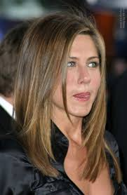 what is the difference between layering and tapering jennifer aniston s hair cut in long layers with angles along the sides