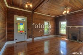 interior living room with wood paneling stock photo and royalty