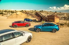 Porsche Cayenne X6 - bmw x6 m vs land rover range rover sport svr vs mercedes amg