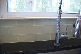 interior khaki and champagne glass subway tile kitchen backsplash