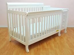 White Convertible Crib With Drawer by Bedroom Gorgeous White Drawers Crib Changer Combo With Laminate Floor