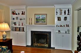 fireplace surrounds with bookcases two fireplaces that share an