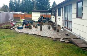 Installing Patio Pavers On Sand How To Install Patio Pavers Existing Concrete Laying Stones