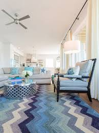 coastal livingroom coastal living room with blue chevron rug spindle chair and linen