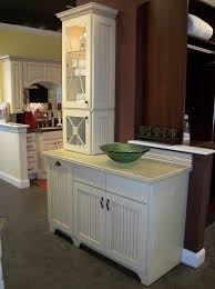 bathroom white wellborn cabinets with black handle on grey