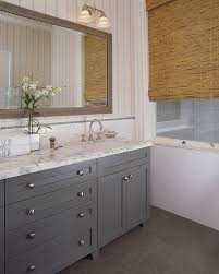 White Bathroom Vanity With Carrera Marble Top by Wick Design Bathrooms Bamboo Roman Shades Gray Bathroom Gray