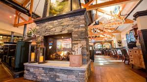 copper door restaurant features new england fireplace and stone