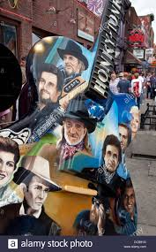 Tennessee travel fan images Honky tonk heroes painted on a large guitar monument on broadway jpg