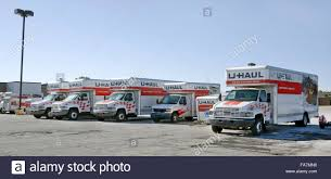 u haul rental trucks and trailers lined up in parking lot stock