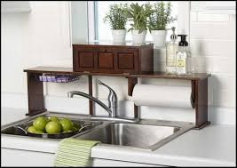 kitchen over the sink shelf with drawers over the sink shelf