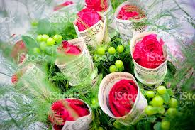 money flowers bouquet from roses flowers are wrapped in money stock photo more