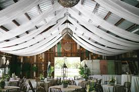 draped ceiling gorgeous barn wedding decor on a budget onlinefabricstore net