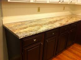 granite countertop zebra wood cabinets kitchen orange backsplash