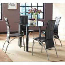set white glass dining table and silver chairs with knocker room