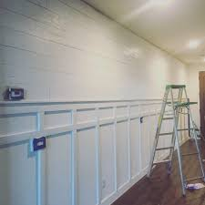shiplap wall diy with board and batten painted in behr maui mist
