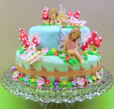fairy cake topper on birthday cakes a fairy garden cake