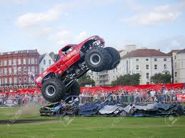 monster truck shows the lil devil monster truck driving over crushed cars at the