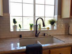 how to put backsplash in kitchen backsplash tile tips if the tile will go around any windows