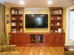 traditional family room with large oak wood flat screen tvs