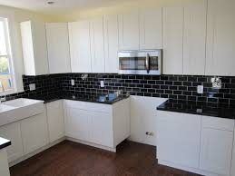 Black And White Kitchens Ideas Photos Inspirations by Black Granite With Black Subway Tile With Thick Grout Line In