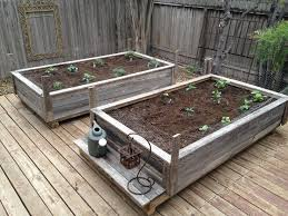 old fence boards used to make raised garden boxes yards flowers
