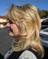 medium layered haircuts over 50 the best hairstyles for women over 50 80 flattering cuts 2018