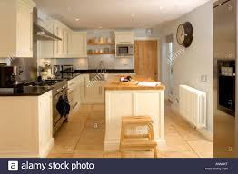 Kitchens With Island by Small Contemporary Fitted Kitchen With Island Unit Stock Photo