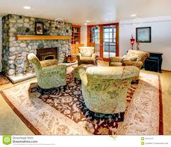 cozy big living room with rock background fireplace royalty free