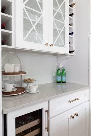 glass cabinets in white kitchen white kitchen with navy blue island wins design award