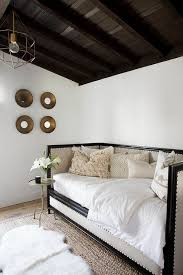 cream and black daybed with moroccan wedding blanket pillows