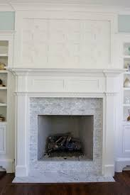 gorgeous greek key fretwork fireplace with white carrara marble