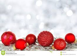 red christmas ornaments with twinkling background stock photo
