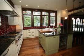 green kitchen island modern distressed green kitchen island with birdcage cabinet