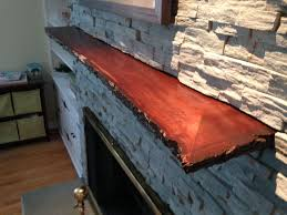hand crafted live edge slab fireplace mantle by mad custom wood