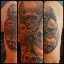 black and gray skull half sleeve by steve malley tattoonow