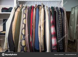 on a shelf clothes hang on a shelf in a designer store stock photo