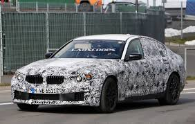 2017 bmw m5 spied with slightly less camouflage